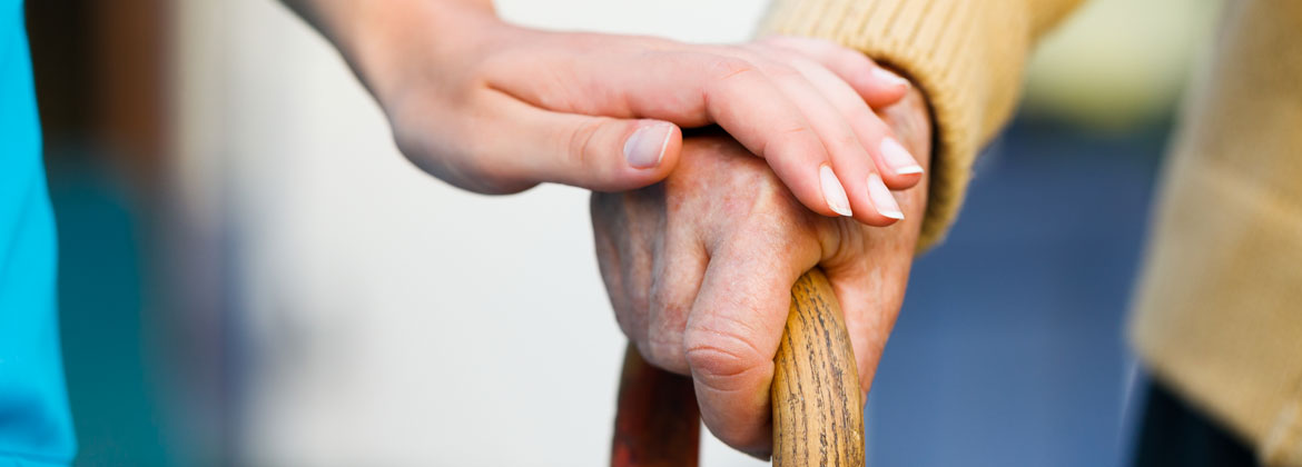 Image of carer and elderly patients' hands